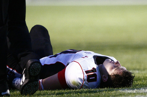Chris Detrick  |  The Salt Lake Tribune Alta's Max Johnson (10) remains on the ground after a hit during the game at East High School Friday August 23, 2013. East is winning the game 21-10 at halftime.