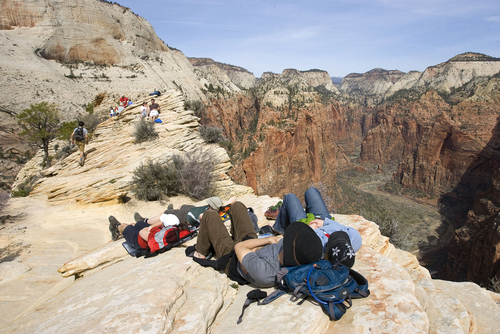 Al Hartmann | The Salt Lake Tribune  Hikers rest along their way to Angels landing in Zion National Park.
