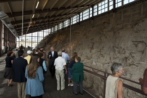 Chris Detrick  |  The Salt Lake Tribune Visitors look at fossils during the Grand Opening Celebration of the Quarry Exhibit Hall at Dinosaur National Monument Tuesday October 4, 2011. The old Quarry Exhibit Hall was closed in July 2006 due to safety hazards. The Carnegie Quarry contains nearly 1,500 fossils. In addition to the fossil wall, the facility features exhibits about dinosaurs and other life from the Jurassic period.