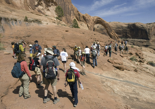 About 200 Jews make the mile-and-a-half hike to Corona Arch for a Passover service on Saturday.    Al Hartmann/Salt Lake Tribune