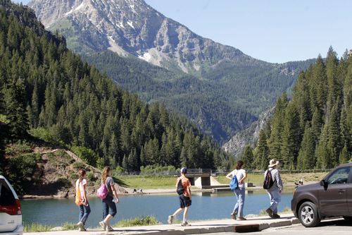 Al Hartmann  |  The Salt Lake Tribune A family takes a hike from parking lot at Tibble Fork Reservoir in American Fork Canyon. The reservoir has the largest parking lot in the canyon and it's busy with bicyclists, fishermen, hikers, picnicers, and off road vehicle riders. The U.S. Forest Service is overhauling its recreational fee program for American Fork Canyon and Mirror Lake Scenic Byway. Instead of charging everyone who drives into these areas, the Forest Service proposes charging only those who use the recreational amenities.