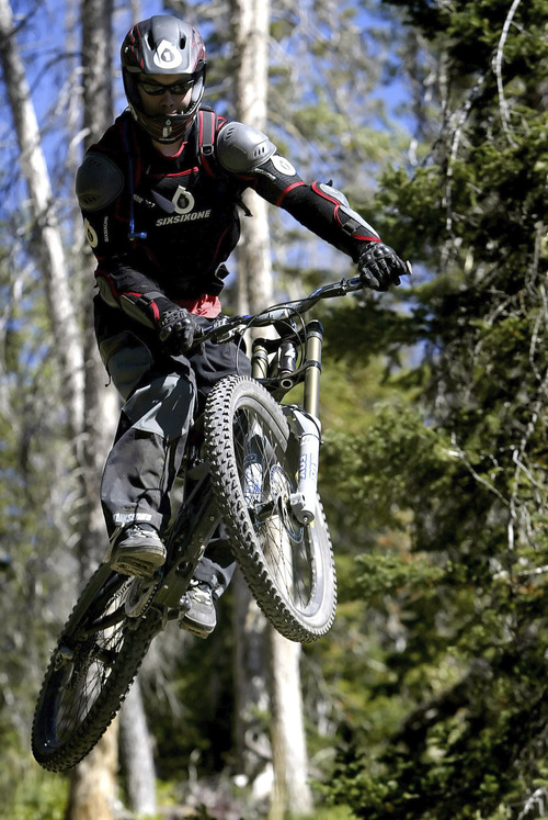 Brian Head,Utah--9/17/2005-- Mike Rex, 23, of St. George, gets some big air after launching off of a ramp at Brian Head resort.  Mountain biking at Brian Head.  ********************************** Photo By: Chris Detrick /Salt Lake Tribune File Number: 816G5830