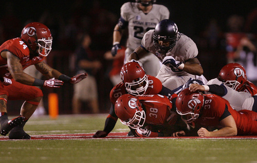 Scott Sommerdorf   |  The Salt Lake Tribune Utah RB Karl Williams recovers an on-side kick to give Utah the ball after they had shaved USU's lead to 23-17. Utah went on to score on William's TD run to take a 24-23 lead. Utah beat Utah State 30-26, Thursday, August 29, 2013.
