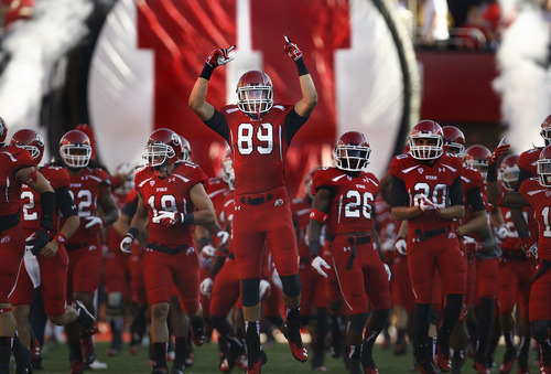 Scott Sommerdorf   |  The Salt Lake Tribune Utah TE Harrison Hanley, #89, leads the rest of the players as take the field during opening ceremonies. Utah later took a quick 7-0 lead over USU early in the 1st period, Thursday, August 29, 2013.