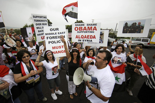 Members of the local Syrian community march in protest against the United States' involvement in Syria, Friday, Aug. 30, 2013, in Allentown, Pa. President Barack Obama says he hasn't made a final decision about a military strike against Syria_but is considering a limited and narrow action in response to a chemical weapons attack that he says Syria's government carried out last week. (AP Photo/Matt Slocum)
