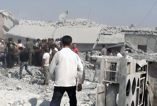 In this citizen journalism image provided by Edlib News Network, ENN, which has been authenticated based on its contents and other AP reporting, Syrians search under rubble to rescue people from houses that were destroyed by a Syrian government warplane, in Idlib province, northern Syria, Friday, Aug. 30, 2013.  President Barack Obama insists Syria must pay the price for chemical attacks that killed hundreds of civilians last week in the outskirts of Beirut and laid the groundwork for an expected punitive military strike. But questions remain about just how, when and who will participate in the strikes.  (AP Photo/Edlib News Network ENN)