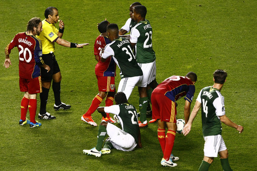 Chris Detrick  |  The Salt Lake Tribune Real Salt Lake forward Jou Plata (8) and Portland Timbers defender Andrew Jean-Baptiste (35) get into a fight during the first half of the game at Rio Tinto Stadium Friday August 30, 2013.