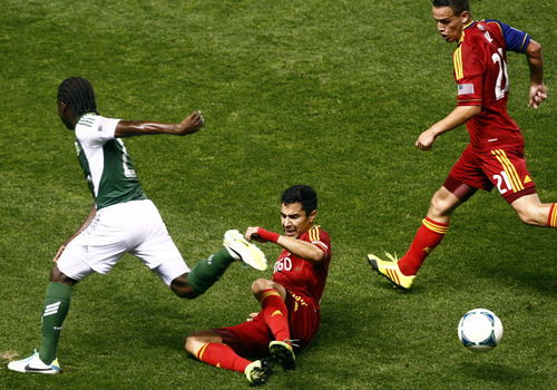 Chris Detrick  |  The Salt Lake Tribune Portland Timbers midfielder Diego Chara (21) Real Salt Lake defender Tony Beltran (2) and Real Salt Lake midfielder Luis Gil (21) go for the ball during the first half of the game at Rio Tinto Stadium Friday August 30, 2013.