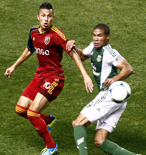 Chris Detrick  |  The Salt Lake Tribune Real Salt Lake forward Robbie Findley (10) and Portland Timbers forward/midfielder Ryan Johnson (9) go for the ball during the first half of the game at Rio Tinto Stadium Friday August 30, 2013.