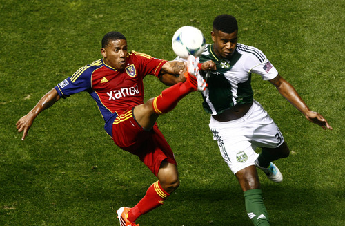 Chris Detrick  |  The Salt Lake Tribune Real Salt Lake forward Jou Plata (8) and Portland Timbers Rauwshan McKenzie (31) go for the ball during the first half of the game at Rio Tinto Stadium Friday August 30, 2013.