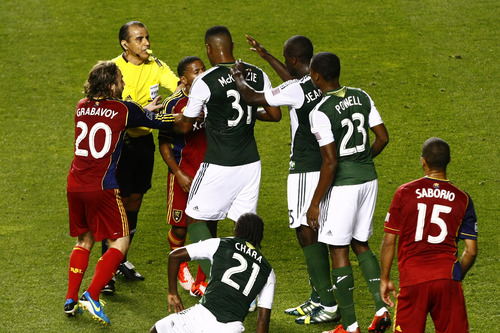 Chris Detrick  |  The Salt Lake Tribune Real Salt Lake midfielder Ned Grabavoy (20) and Portland Timbers Rauwchan McKenzie (31) try to break up a fight between Real Salt Lake forward Jou Plata (8) and Portland Timbers defender Andrew Jean-Baptiste (35) during the first half of the game at Rio Tinto Stadium Friday August 30, 2013.