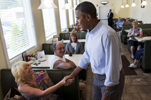 """FILE - In this Aug. 23, 2013, file photo, President Barack Obama greets patrons at Bingham's Family Restaurant, where he stopped to buy pie, in Lenox, Pa. Obama still calls shoring up the middle class his """"No. 1 priority,"""" but recent events overseas and at home are overshadowing the U.S. economy as a political issue. The civil war in Syria and alleged use by Damascus of chemical weapons, political turmoil in Egypt and revelations about the extent of the National Security Agency's surveillance programs are complicating Obama's efforts to keep the focus on the economy.  (AP Photo/Jacquelyn Martin, File"""