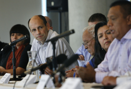 Scott Sommerdorf      The Salt Lake Tribune Atorney Mark Alvarez, left, listens as immigrant activist Tony Yapias speaks speaks after a roundtable discussion on immigration hosted by Salt Lake City Mayor Ralph Becker, along with business leaders as Congress begins debate on comprehensive immigration reform bill, Wednesday, June 12, 2013.