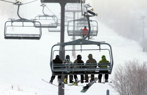 Francisco Kjolseth  |  Tribune file photo Skiers and snowboarders ride the Payday lift at Park City Mountain Resort on the last day of 2012. PCMR is locked in a legal battle with Vail Resorts over the lease of 3,700 acres of its ski terrain.