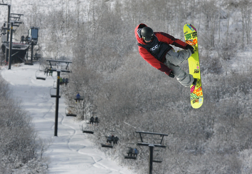 Scott Sommerdorf   |  The Salt Lake Tribune Max Raymer of Park City jumps during the Open Division of the Recon Tour Snowboard competition at Park City Mountain Resort, Sunday, January 13, 2013. PCMR is locked in a legal battle with Vail Resorts over the lease of 3,700 acres of its ski terrain and has served with an eviction notice.