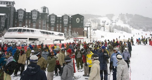 Skiiers queue up to grab a ride on the Payday high speed six pack lift at Park City Mountain Resort. PCMR is locked in a legal battle with Vail Resorts over the lease of 3,700 acres of its ski terrain.    Al Hartmann/Salt Lake Tribune