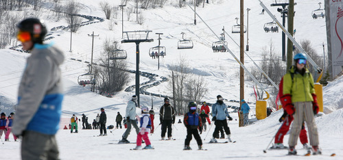 Steve Griffin  |  The Salt Lake Tribune  Skiers and snowboarders make their way down a run at Park City Mountain Resort in Park City, Utah  Monday, February 20, 2012. The resort is battling wit Vail Resorts over the lease of 3,700 acres of ski terrain and has been served with an eviction notice.