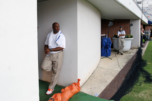 Virginia head coach Mike London watches the rain fall from the door to the locker room after lightning from a storm caused officials to evacuate the Scott Stadium during the first half of an NCAA college football game, Saturday, Aug. 31, 2013 in Charlottesville, Va. (AP Photo/The Progress-Index, Andrew Shurtleff)