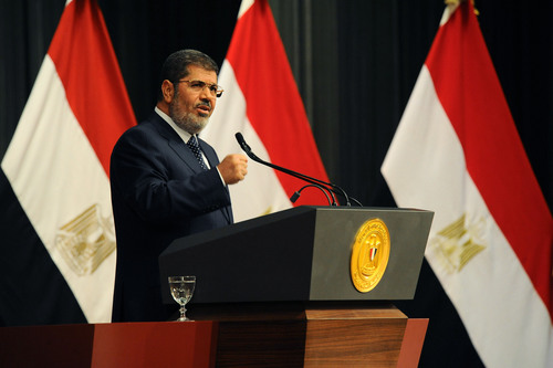 FILE - In this Wednesday, June 26, 2013 file photo released by the Egyptian Presidency, Egyptian President Mohammed Morsi delivers a speech in Cairo, Egypt. Egypt's state news agency said Sunday, Sept. 1, 2013, the country's top prosecutor has referred ousted Islamist President Mohammed Morsi to trial on charges of inciting the killing of opponents protesting outside his palace while he was in office. (AP Photo/Egyptian Presidency, File)