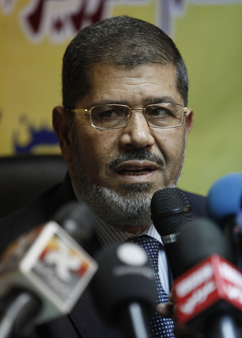 FILE - In this Monday, Nov. 22, 2010 file photo, then Muslim Brotherhood spokesman Mohammed Morsi speaks during a press conference alleging early fraud in Egypt parliamentary elections at the group's offices in Cairo, Egypt. Egypt's state news agency said Sunday, Sept. 1, 2013, the country's top prosecutor has referred ousted Islamist President Mohammed Morsi to trial on charges of inciting the killing of opponents protesting outside his palace while he was in office. (AP Photo/Nasser Nasser, File)