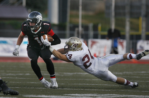 Scott Sommerdorf   |  The Salt Lake Tribune Alta's WR MAck Richards is grabbed by Lone Peak DB Zach Buhrley. Lone Peak held a 10-7 lead over Alta at the half, Friday, August 30, 2013.