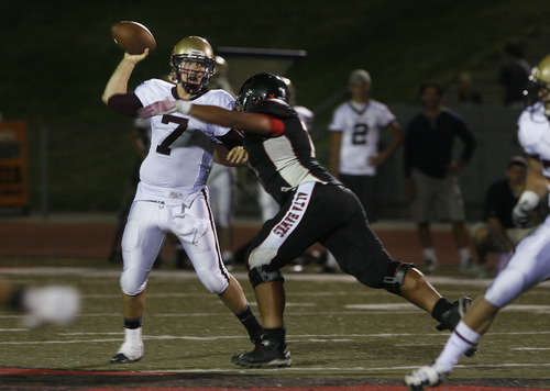 Scott Sommerdorf   |  The Salt Lake Tribune Lone Peak backup QB Jared Collins came in after Baron Grajkowski was injured. Alta beat Lone Peak 35-17 in Sandy, Friday, August 30, 2013.