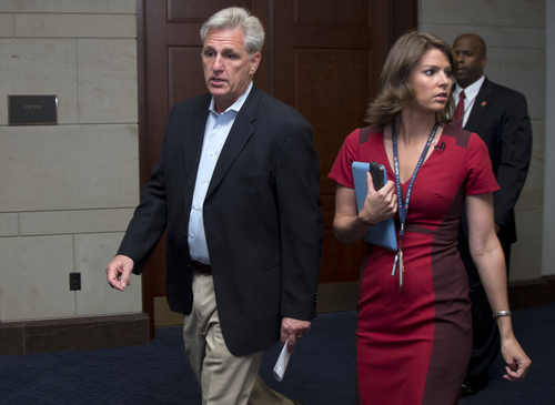 House Majority Whip Rep. Kevin McCarthy, left, R-Calif., walks into a classified members-only briefing on Syria on Capitol Hill, Sunday, Sept. 1, 2013, in Washington. Sunday the Obama administration confidently predicted congressional backing for limited action in Syria as senior administration officials are briefing members of Congress in private. Further classified meetings are scheduled over the next three days, says the Secretary of State John Kerry.  (AP Photo/Carolyn Kaster)
