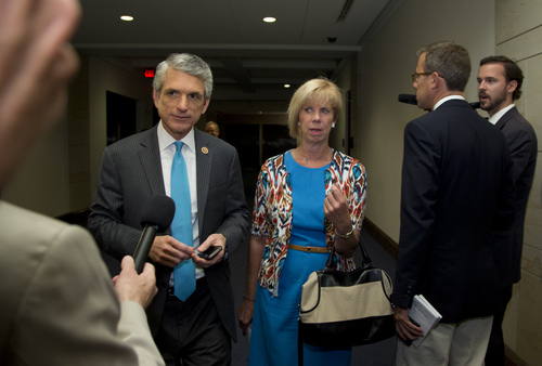 Rep. Scott Rigell, R-Va, left, and Rep. Janice Hahn, D-Ca., walk to a classified members-only briefing on Syria by senior administration officials on Capitol Hill, Sunday, Sept. 1, 2013, in Washington. Sunday the Obama administration confidently predicted congressional backing for limited action in Syria. Further classified meetings are scheduled in upcoming days. AP Photo/Carolyn Kaster)