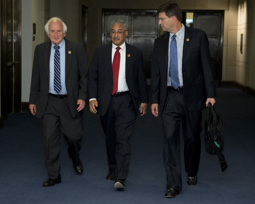 From left, Rep. Sander Levin, D-Mich., Rep. Robert Scott, D-Va., and Rep. Brad Schneider, D- ll., walk a closed members-only briefing on Syria on Capitol Hill, Sunday, Sept. 1, 2013, in Washington. Sunday the Obama administration confidently predicted congressional backing for limited action in Syria. Further classified meetings are scheduled over the next three days, says Secretary of State John Kerry. (AP Photo/Carolyn Kaster)