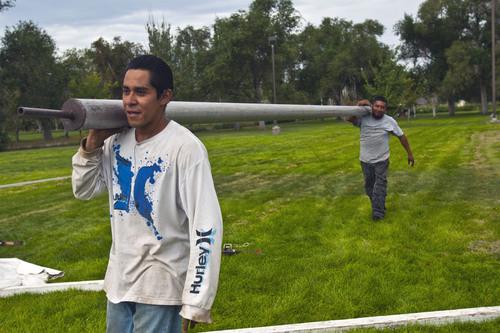 Chris Detrick     The Salt Lake Tribune Diamond Rental's Oscar Bernardino and Erik Gallardo work at setting up tents at Magna Park Sunday September 1, 2013.