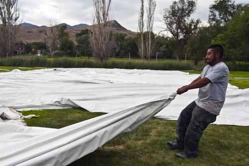 Chris Detrick     The Salt Lake Tribune Diamond Rental's Erik Gallardo works at setting up tents at Magna Park Sunday September 1, 2013.