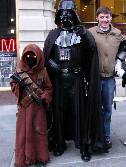 Mark Fordham and his son, Brent (as a Jawa), pose with a fan in 2007. (Courtesy of Mark Fordham)