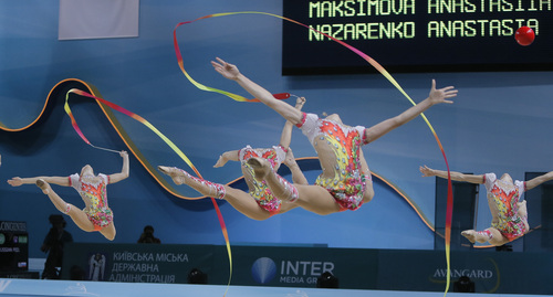 The team from Russia performs with ribbons and balls during the  32nd rhythmic gymnastics world championships  in Kiev,  Ukraine, Sunday,  Sept. 1, 2013. (AP Photo/Efrem Lukatsky)