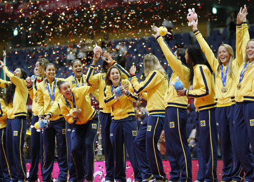 Brazil's players celebrate with the gold medal during an awarding ceremony of  World Grand Prix Finals woman's volleyball tournament in Sapporo, northern Japan, Sunday, Sept. 1, 2013. Brazil won the round-robin tournament Sunday. (AP Photo/Koji Sasahara)