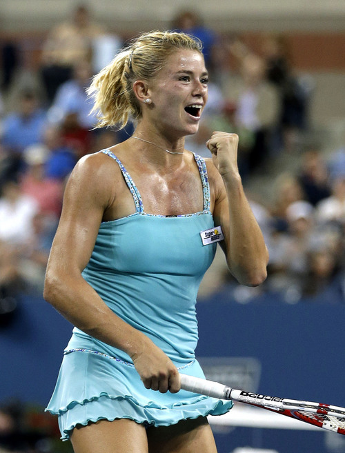 Camila Giorgi, of Italy, reacts after defeating Caroline Wozniacki, Denmark, in a third round match at the U.S. Open tennis tournament Saturday, Aug. 31, 2013, in New York. (AP Photo/Darron Cummings)