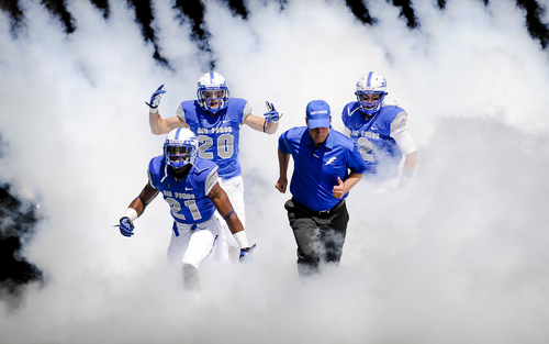 Air Force Academy football players and head coach Troy Calhoun run out onto the field for an NCAA college football game against Colgaite Saturday, Aug., 31, 2013, in Air Force Academy, Colo. (AP Photo/The Colorado Springs Gazette, Michael Ciaglo) MAGS OUT