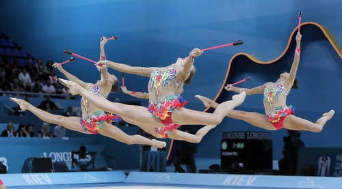 The team from Russia perform during the  32nd rhythmic gymnastics world championships, in Kiev, Ukraine, Saturday, Aug. 31, 2013. (AP Photo/Efrem Lukatsky)