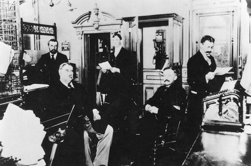 Thatcher Bank in Logan, Utah.  Front row left to right, George W. Thatcher, H. E.Hatch and George Farr Thatcher. Back row, left to right: John Stein (bookeeper), Roy D. Thatcher;