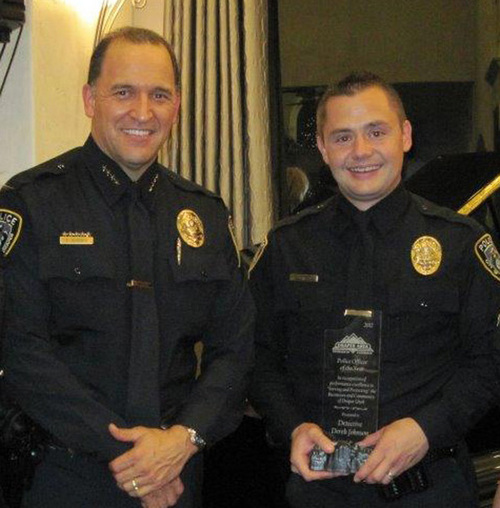 Courtesy Draper City Sgt. Derek Johnson, right, receives a community policing award in 2012 from Draper Police Chief Bryan Roberts. Johnson, 32, was shot and killed about 6 a.m. Sunday, Sept. 1.