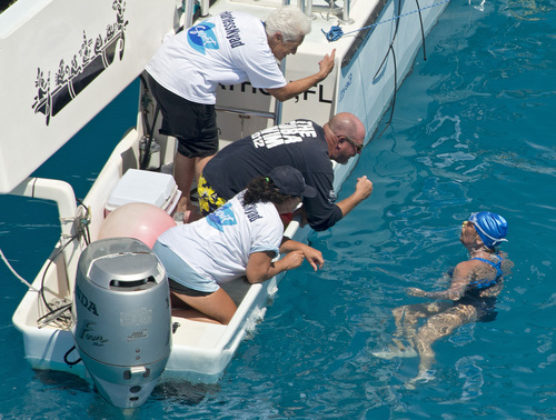 In this photo provided by the Florida Keys News Bureau, swimmer Diana Nyad talks with her crew less than two miles off Key West, Fla., Monday, Sept. 2, 2013. Nyad, 64, is poised to be the first swimmer to cross the Florida Straits from Cuba to the Florida Keys without the security of a shark cage. (AP Photo/Florida Keys News Bureau, Andy Newman)
