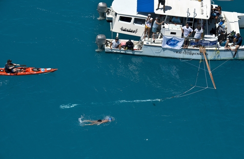 In this photo provided by the Florida Keys News Bureau, Diana Nyad, positioned about two miles off Key West, Fla., Monday, Sept. 2, 2013, swims towards the completion of her 111-mile trek from Cuba to the Florida Keys. Nyad, 64, is poised to be the first swimmer to cross the Florida Straits without the security of a shark cage. (AP Photo/Florida Keys News Bureau, Andy Newman)