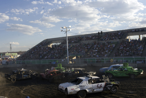 Kim Raff | The Salt Lake Tribune People compete in a heat during the Demolition Derby on the last day of the Utah State Fair in Salt Lake City, Utah on September 16, 2012.