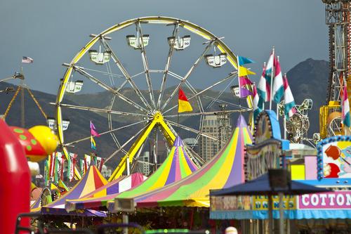 Chris Detrick  |  The Salt Lake Tribune The Thomas Carnival Century Wheel rises above the midway at the Utah State Fair Thursday September 6, 2012.