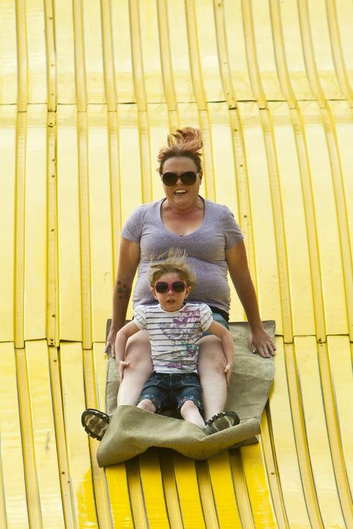 Chris Detrick  |  The Salt Lake Tribune Heather Clemons and Persephone Clemons, 4, go down the Giant Slide at the Utah State Fair Thursday September 6, 2012.