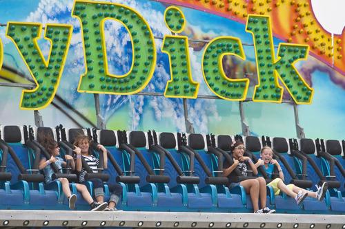 Chris Detrick  |  The Salt Lake Tribune Children ride Moby Dick at the Utah State Fair Thursday September 6, 2012.