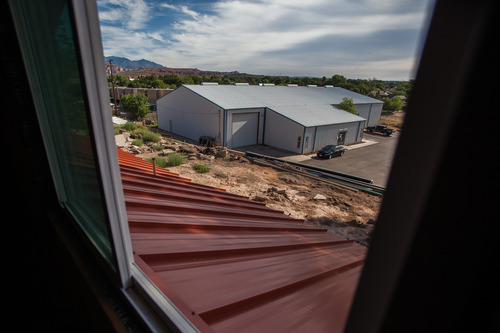 Trevor Christensen     Special to the Tribune  The view of Dixie Gun Worx from an apartment in Adelante Village, a women's shelter currently under construction by the Erin Kimball Memorial Foundation, on Wednesday, August 21, 2013.