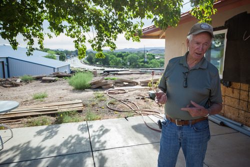 Trevor Christensen     Special to the Tribune  Co-founder of the Erin Kimball Memorial Foundation, Don Kimball, outside Adelante Village, a women's shelter under construction by the Erin Kimball Memorial Foundation on Wednesday, August 21, 2013. Dixie GunWorx, a firearms and gunsmithing shop, can be see in the background.