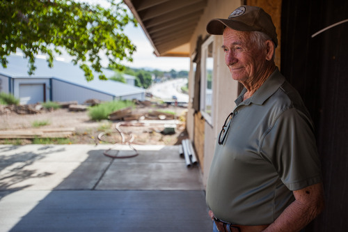 Trevor Christensen  |  Special to the Tribune  Co-founder of the Erin Kimball Memorial Foundation, Don Kimball, outside Adelante Village, a women's shelter currently under construction by the Erin Kimball Memorial Foundation on Wednesday, August 21, 2013. Dixie GunWorx, a firearms and gunsmithing shop, can be see in the background.