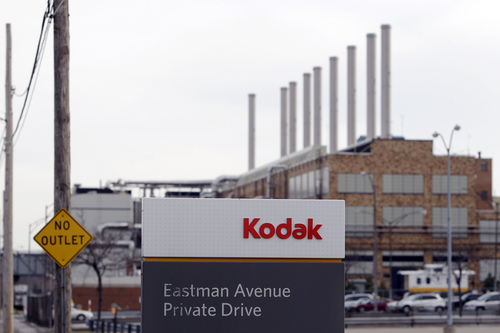 FILE - This Jan. 6, 2012 file photo shows a Kodak factory in Rochester, N.Y. On Tuesday, Aug. 20, 2013, a federal judge approved Kodak's plan to emerge from bankruptcy protection. The ruling paves the way for the photography pioneer to emerge from court oversight as a new company focused on commercial and packaging printing. The company has said it hopes to emerge from bankruptcy protection on Sept. 3, 2013. (AP Photo/David Duprey)