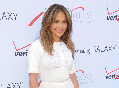 """FILE - This July 26, 2013 file photo shows singer and actress Jennifer Lopez at the """"Viva Movil by Jennifer Lopez"""" flagship store grand opening in the Brooklyn borough of New York.  Fox announced Tuesday, Sept. 3, 2013 that Lopez, along with Harry Connick Jr. and Keith Urban will be judges on the upcoming season of """"American Idol."""" (Photo by Evan Agostini/Invision/AP, File)"""